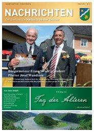 Bürgermeister Franz Straßl gratuliert Pfarrer Josef Wundsam