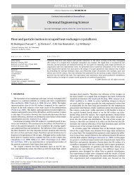 Flow and particle motion in scraped heat exchanger crystallizers