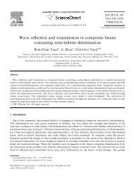 Wave reflection and transmission in composite beams containing ...