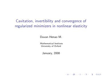 Cavitation, invertibility and convergence of regularized minimizers in ...