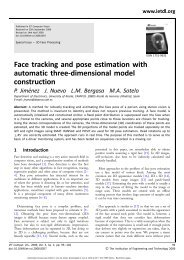 Face tracking and pose estimation with automatic three-dimensional ...