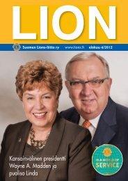 Kansainvälinen presidentti Wayne A. Madden ja puoliso Linda