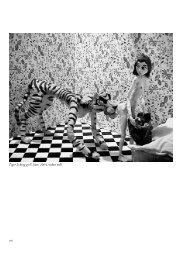 Tiger licking girl's butt, 2004, video still - 4. Berlin Biennale