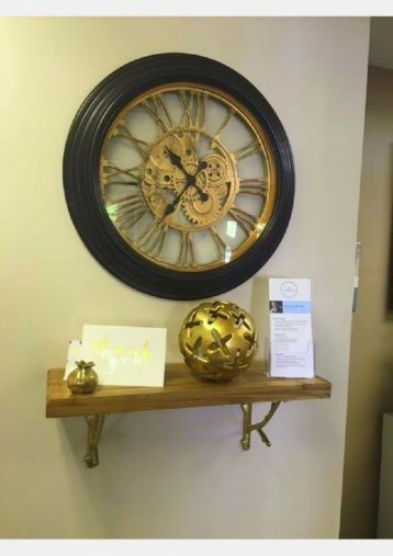 Classic clock at Van Hala Dental Group located just a few paces to the south of Hudson Clock Tower