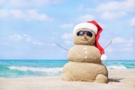 bigstock-Smiling-Sandy-Snowman-In-Red-S-72707650