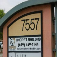 Signboard outside the office of Trinity Family Dental