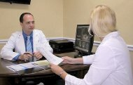 cosmetic dentist and dental hygienist at Marco Dental Care planning a dental procedure
