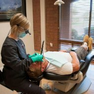 Dental hygienist prepares patient for periodontal treatment at Torghele dentistry