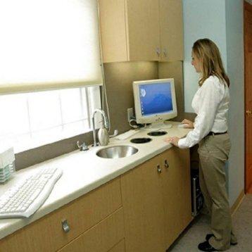 Dental hygienist at work at office of dentist Rolando Cibischino, DMD