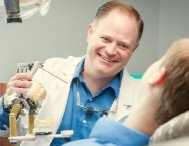 Spokane Prosthodontist Dr. Molgard sharing lighter moments with patient