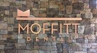 Signage on the wall at Moffitt Dental Center