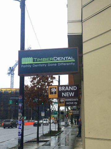 Signboard outside the office of Portland dentist Timber Dental East Burnside
