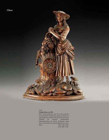 3630* Tischuhr, Brienz, um 1900 Holz, vollrund geschnitzt. Die Uhr ...